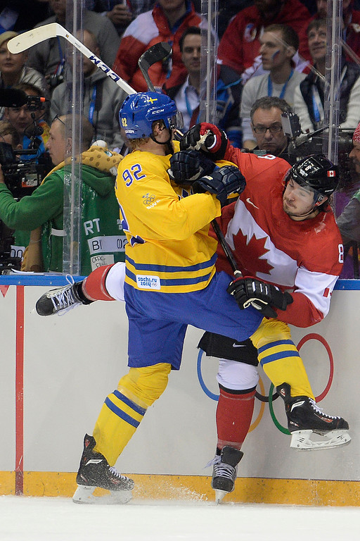 . Gabriel Landeskog (92) of Sweden checks Drew Doughty (8) of Canada during the second period of the men\'s ice hockey gold medal game. Sochi 2014 Winter Olympics on Sunday, February 23, 2014 at Bolshoy Ice Arena. (Photo by AAron Ontiveroz/ The Denver Post)