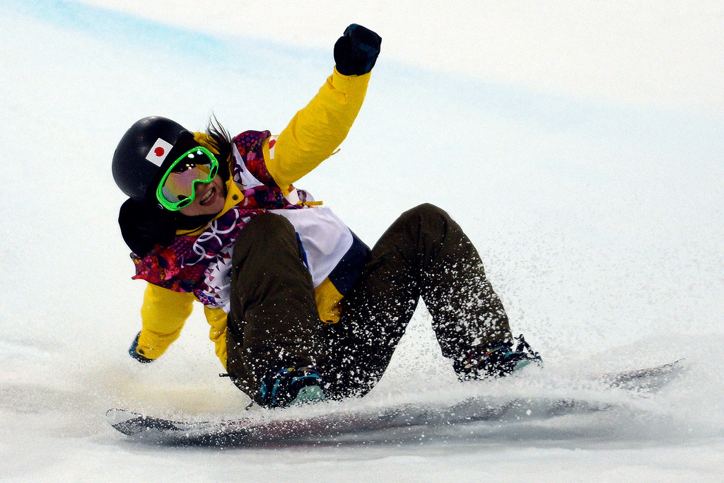 . Japan\'s Rana Okada wipes out during a women\'s snowboard halfpipe final at the Rosa Khutor Extreme Park on Wednesday, February 12, 2014. (Photo by AAron Ontiveroz/The Denver Post)