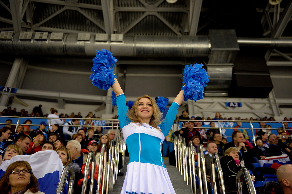 . Cheerleaders fire up the crowd during the third period of the United States\' 3-1 women\'s hockey win against Finland on Saturday, February 8, 2014. (Photo by AAron Ontiveroz/The Denver Post)