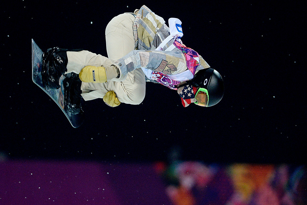 . U.S. snowboarder Shaun White rides during the men\'s snowboard halfpipe final at the Sochi 2014 Winter Olympics on Tuesday, February 11, 2014. (Photo by AAron Ontiveroz/The Denver Post)