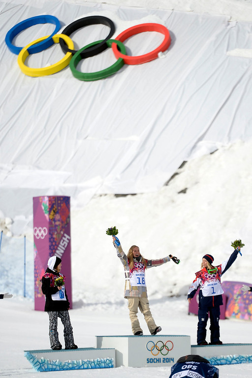 . Gold medalist Jamie Anderson, of the U.S.A., celebrates with silver medalist Enni Rukajarvi, of Finland (left) and bronze medalist Jenny Jones, of Great Britain, during the women\'s snowboard slopestyle final on Sunday, February 9, 2014. (Photo by AAron Ontiveroz/The Denver Post)