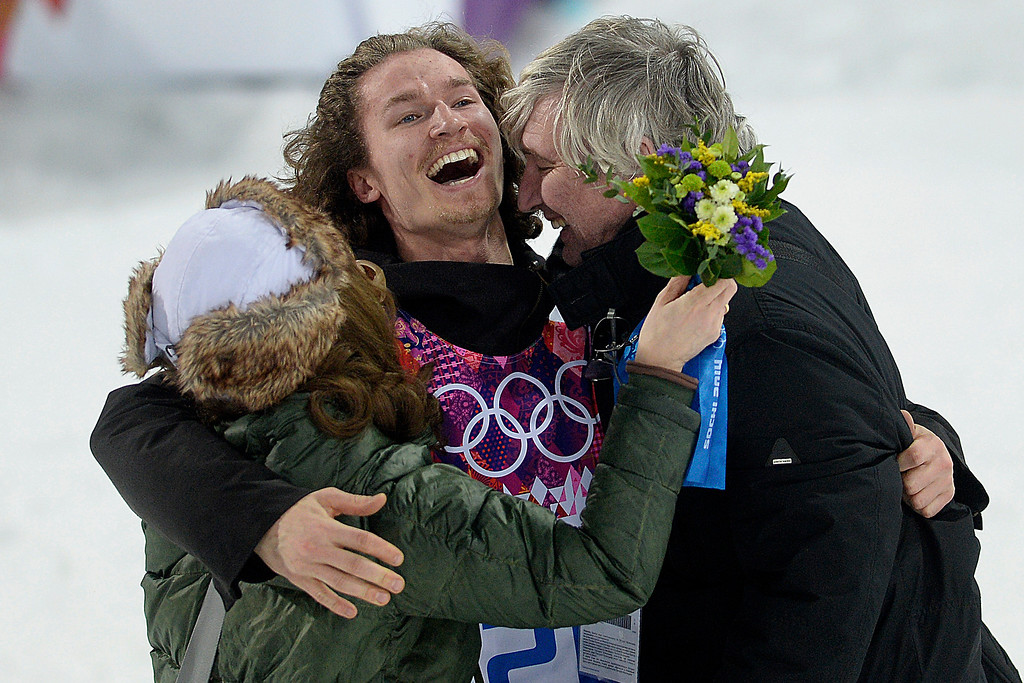 . Gold medalist Iouri Podladchikov of Switzerland hugs his parents Yurii and Valentina after the men\'s snowboard halfpipe final at the Sochi 2014 Winter Olympics in Sochi, Russia, on Tuesday, February 11, 2014. Podladchikov knocked off two-time defending gold medalist Shaun White as the event\'s top placer.   (Photo by AAron Ontiveroz/The Denver Post)