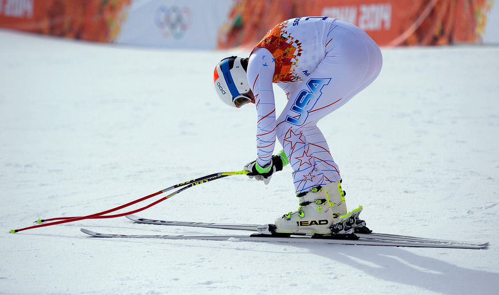 . United States skier Bode Miller bends over in disappointment after failing to crack the top three during the alpine skiing men\'s downhill final at the Rosa Khutor Alpine Resort on Sunday, February 9, 2014. (Photo by AAron Ontiveroz/The Denver Post)