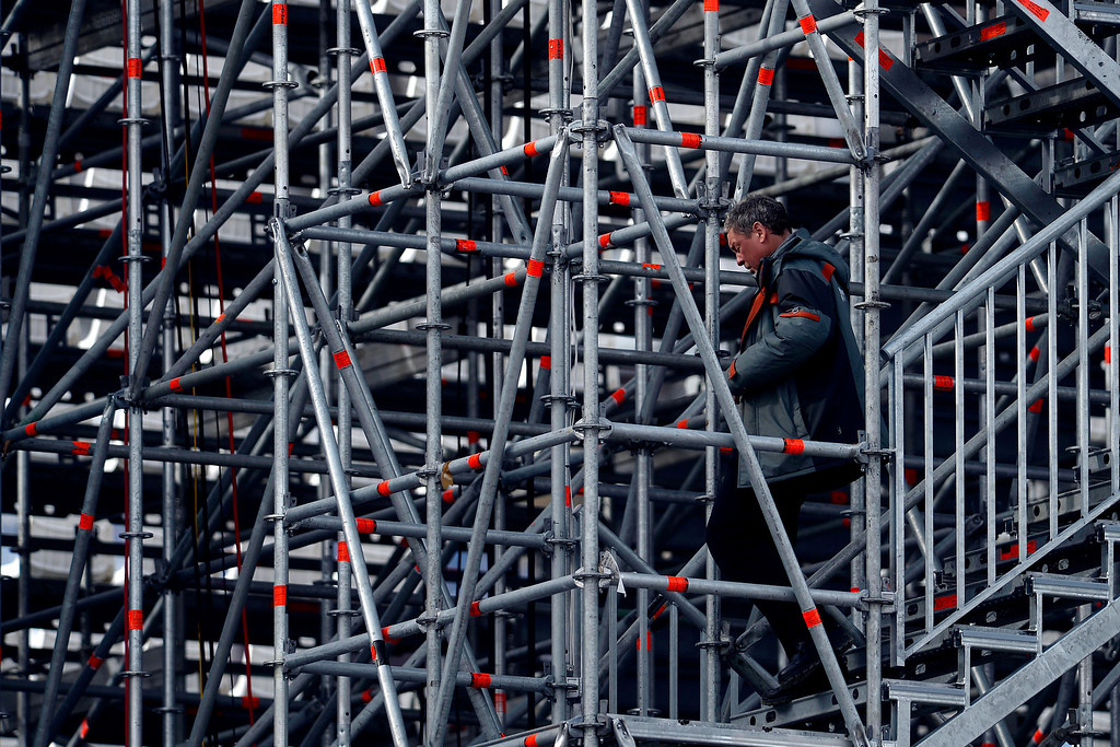 . A man navigates the stairs of the grandstand during the women\'s snowboard slopestyle final. Sochi 2014 Winter Olympics at the Rosa Khutor Etreme Park on Sunday, February 9, 2014. (Photo by AAron Ontiveroz/The Denver Post)