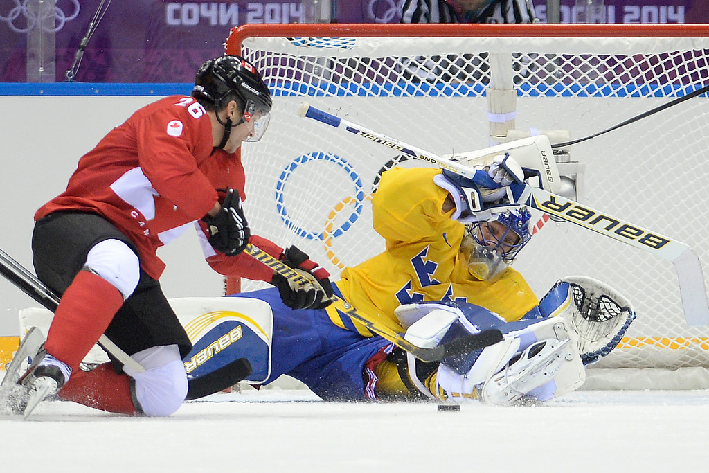. Martin St-Louis (26) of Canada takes a shot on Henrik Lundqvist (30) of Sweden during the second period of the men\'s ice hockey gold medal game. Sochi 2014 Winter Olympics on Sunday, February 23, 2014 at Bolshoy Ice Arena. (Photo by AAron Ontiveroz/ The Denver Post)