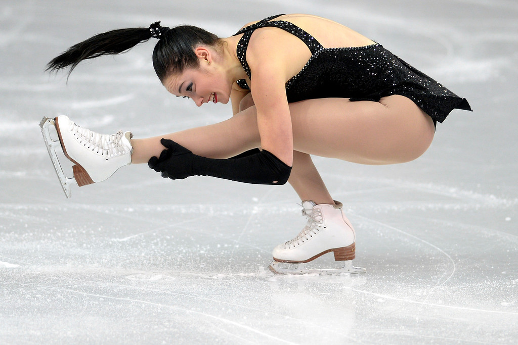 . Canada\'s Kaetlyn Osmond tucks en route to a 62.54 in ladies short program during team figure skating on Saturday, February 8, 2014. (Photo by AAron Ontiveroz/The Denver Post)