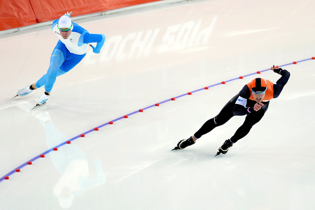 . Silver medalist Jan Smeekens takes the lead around the first turn on Finland\'s Mika Poutala during the speed skating men\'s 500-meter at Adler Arena on Monday, February 10, 2014. (Photo by AAron Ontiveroz/The Denver Post)