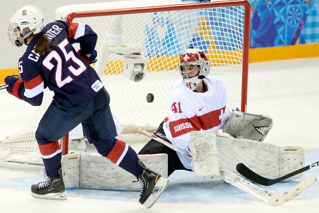 . Alex Carpenter (25) of the U.S.A. scores the ninth goal of the game for her team on Florence Schelling (41) of the Switzerland during the third period of the United States\' 9-0 win at the Shayba Arena.   (Photo by AAron Ontiveroz/The Denver Post)
