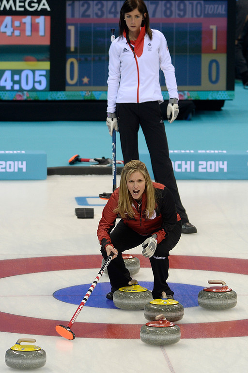 . Great Britain skip Eve Muirhead watches on as Canadian skip Jennifer Jones shouts to teammates during a women\'s curling qualifier at the Ice Cube Curling Center. Sochi 2014 Winter Olympics on Wednesday, February 12, 2014. (Photo by AAron Ontiveroz/The Denver Post)