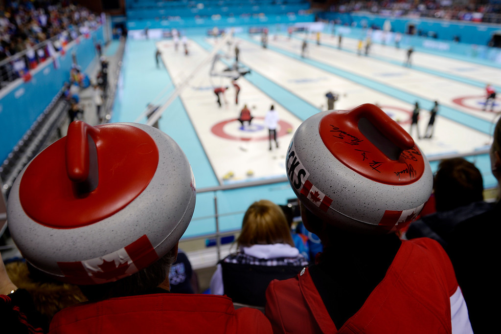 . David and Debbie Stone of Sault St. Marie, Ontario, Canada watch the action between Great Britain and Canada during a women\'s curling qualifier at the Ice Cube Curling Center on Wednesday, February 12, 2014. (Photo by AAron Ontiveroz/The Denver Post)