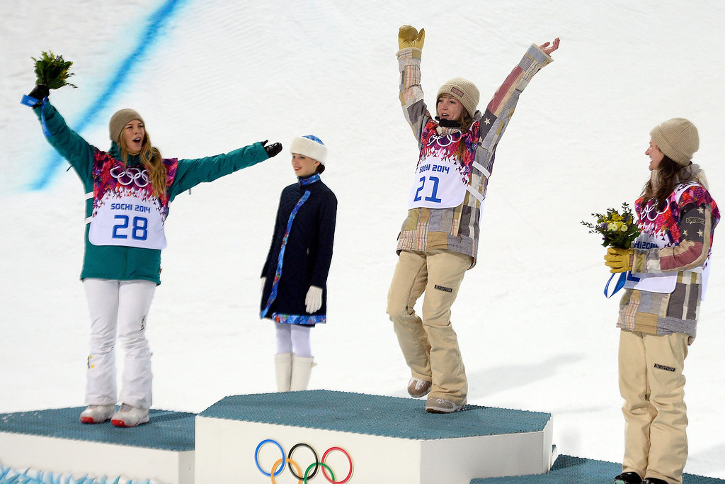 . American gold medalist Kaitlyn Farrington celebrates as silver medalist Australian Torah Bright (left) and bronze medalist American Kelly Clark look on after  women\'s snowboard halfpipe final at the Rosa Khutor Extreme Park.   (Photo by AAron Ontiveroz/The Denver Post)