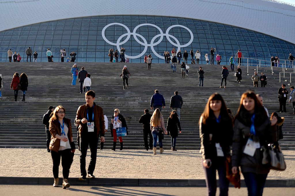 . People mingle in front of the Bolshoy Ice Arena during opening weekend at the Olympic village at the Sochi 2014 Winter Olympics on Saturday, February 8, 2014. (Photo by AAron Ontiveroz/The Denver Post)