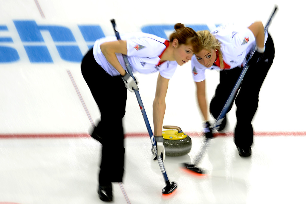 . Great Britain\'s Claire Hamilton (left) and Anna Sloan sweep during a women\'s curling qualifier against Canada at the Ice Cube Curling Center. Sochi 2014 Winter Olympics on Wednesday, February 12, 2014. (Photo by AAron Ontiveroz/The Denver Post)