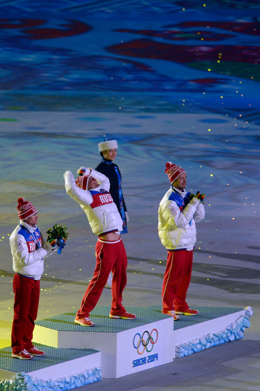 . Mass start cross country champion Russian Alexander Legkov celebrates as fellow countrymen Maxim Vylegzhanin (left) and Ilia Chernousov (bronze) during closing ceremony for the Sochi 2014 Winter Olympics. Sochi 2014 Winter Olympics on Sunday, February 23, 2014 at Fisht Olympic Stadium. (Photo by AAron Ontiveroz/ The Denver Post)