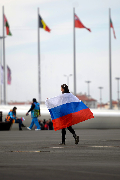 . Nadegda Pavlova walks with the Russian flag in the Sochi 2014 Olympic park. Sochi 2014 Winter Olympics on Friday, February 14, 2014. (Photo by AAron Ontiveroz/The Denver Post)