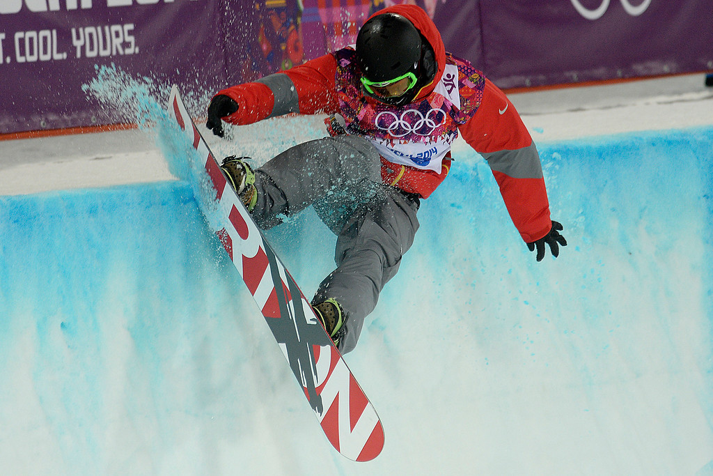 . China\'s Shi Wancheng hits the lip during the men\'s snowboard halfpipe final on Tuesday, February 11, 2014. (Photo by AAron Ontiveroz/The Denver Post)