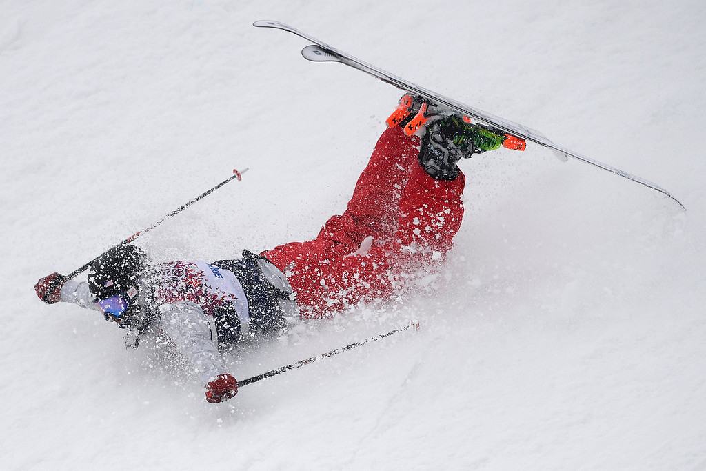. U.S. skier Devin Logan slides on her stomach after crashing during the women\'s ski slopestyle final on Tuesday, February 11, 2014. (Photo by AAron Ontiveroz/The Denver Post)