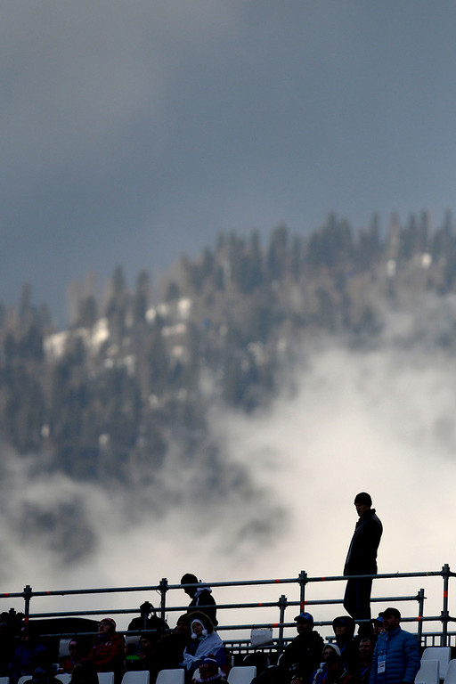 . A man is silhouetted against the fog during ladies\' slalom run 2. Sochi 2014 Winter Olympics on Friday, February 21, 2014 at Rosa Khutor Alpine Center. (Photo by AAron Ontiveroz/ The Denver Post)