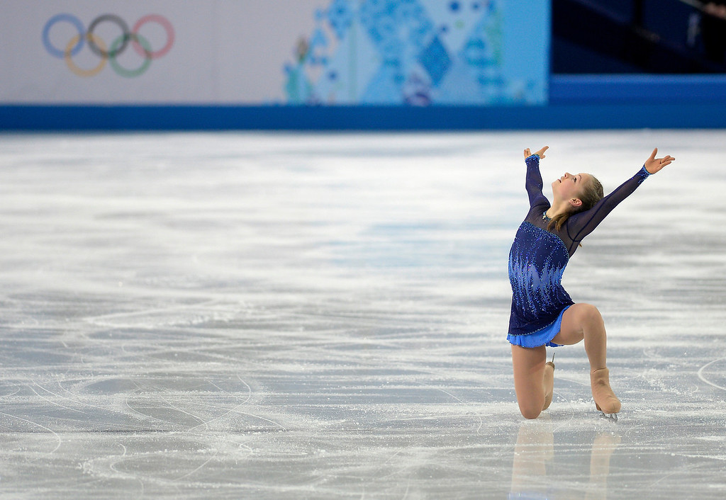 . Russia\'s Yulia Lipnitskaya dazzles the crown en route to scoring a leading 72.90 during team figure skating at the Sochi 2014 Winter Olympics on Saturday, February 8, 2014. (Photo by AAron Ontiveroz/The Denver Post)