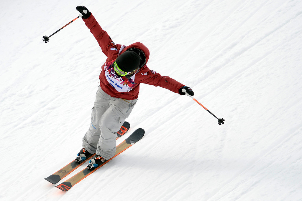 . Canada\'s Dara Howell celebrates her gold medal during the women\'s ski slopestyle final on Tuesday, February 11, 2014. (Photo by AAron Ontiveroz/The Denver Post)