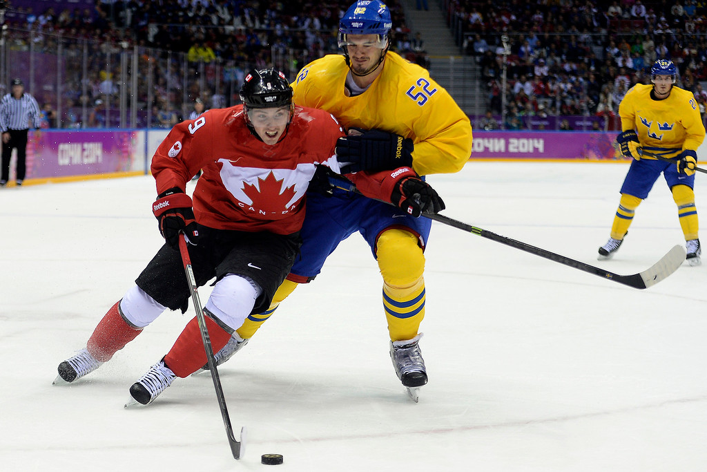 . Matt Duchene (9) of Canada is defended by Jonathan Ericsson (52) of Sweden during the first period of the men\'s ice hockey gold medal game. Sochi 2014 Winter Olympics on Sunday, February 23, 2014 at Bolshoy Ice Arena. (Photo by AAron Ontiveroz/ The Denver Post)