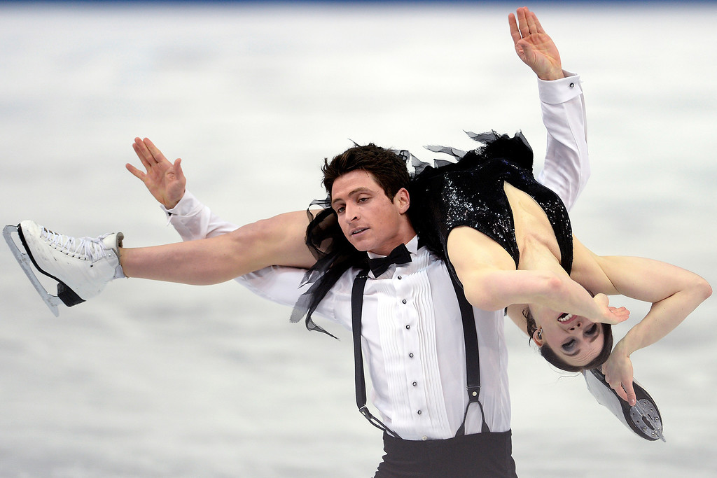 . Canada\'s Scott Moir and Tessa Virtue perform en route to a 72.98 in ice dance short during team figure skating on Saturday, February 8, 2014. (Photo by AAron Ontiveroz/The Denver Post)