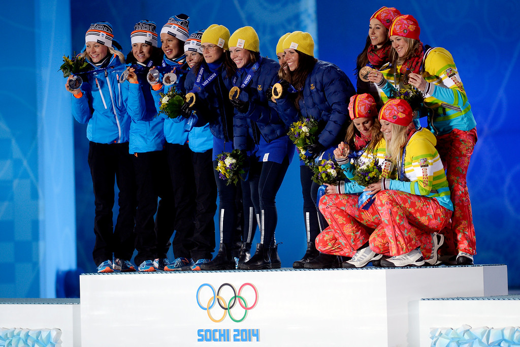 . The winners (teams from left to right silver medalists Finland, gold medalists Sweden and bronze medalists Germany) take the stage for the women\'s 4x5km cross country skiing team relay during the evening medals ceremony. Sochi 2014 Winter Olympics on Sunday, February 16, 2014. (Photo by AAron Ontiveroz/The Denver Post)