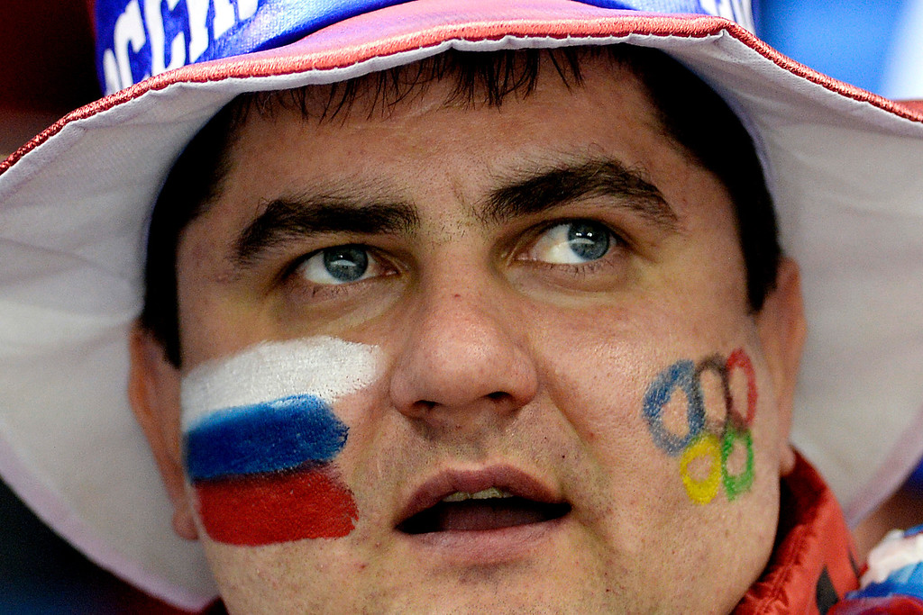 . A Russian fan watches the women\'s hockey action between the U.S.A. and Switzerland during the second period at the Shayba Arena on Monday, February 10, 2014. (Photo by AAron Ontiveroz/The Denver Post)