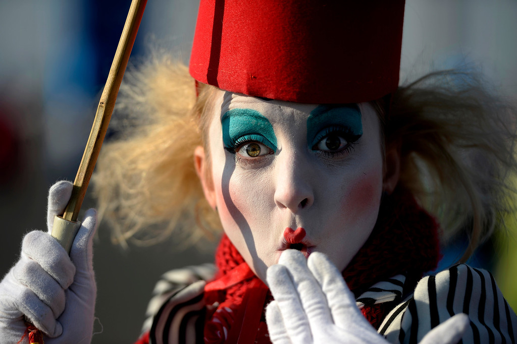 . A performer named Tatya entertains spectators during opening weekend at the Olympic village on Saturday, February 8, 2014. (Photo by AAron Ontiveroz/The Denver Post)