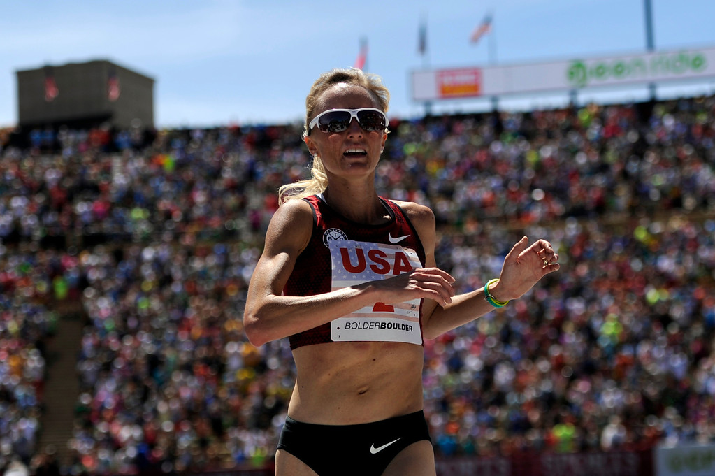 . Shalane Flanagan (2), of crosses the finish line as the top American in the 2014 Bolder Boulder 10K elite women\'s race on Memorial Day, May 26, 2014. (Photo By Lindsay Pierce/The Denver Post)