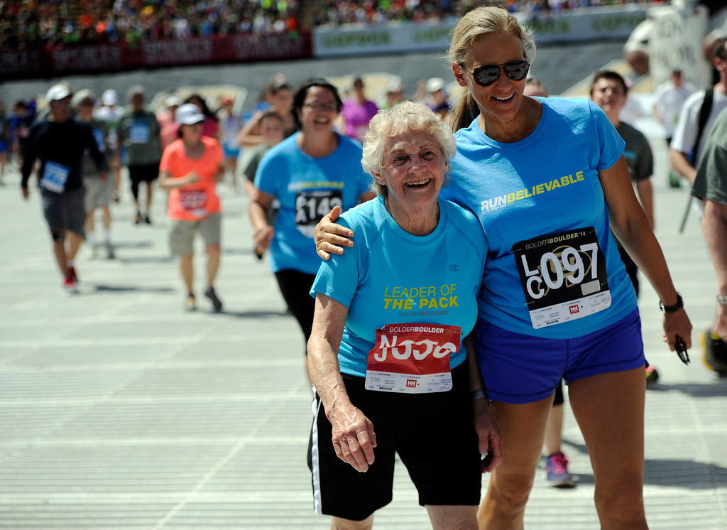 . Kay Fial hugs her mother, Ione Norby, 83, as they cross the finish line of the 36th Annual Bolder Boulder 10K road race on Memorial Day, May 26, 2014. (Photo By Lindsay Pierce/The Denver Post)