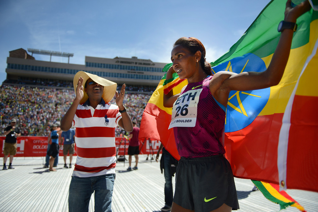. Mamitu Daska holds the Ethiopian flag after crossing the finish line as the first female finisher in the international team race at the 36th Annual BolderBOULDER 10K road race on Memorial Day, May 26, 2014.  (Photo By Lindsay Pierce/The Denver Post)
