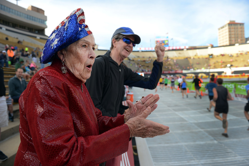 . Joyce Bowen, of Boulder, watches for her grandson as runners finish the 36th Annual BolderBOULDER 10K road race inside Folson Field at Colorado University campus in Boulder on Memorial Day, May 26, 2014.  (Photo By Lindsay Pierce/The Denver Post)