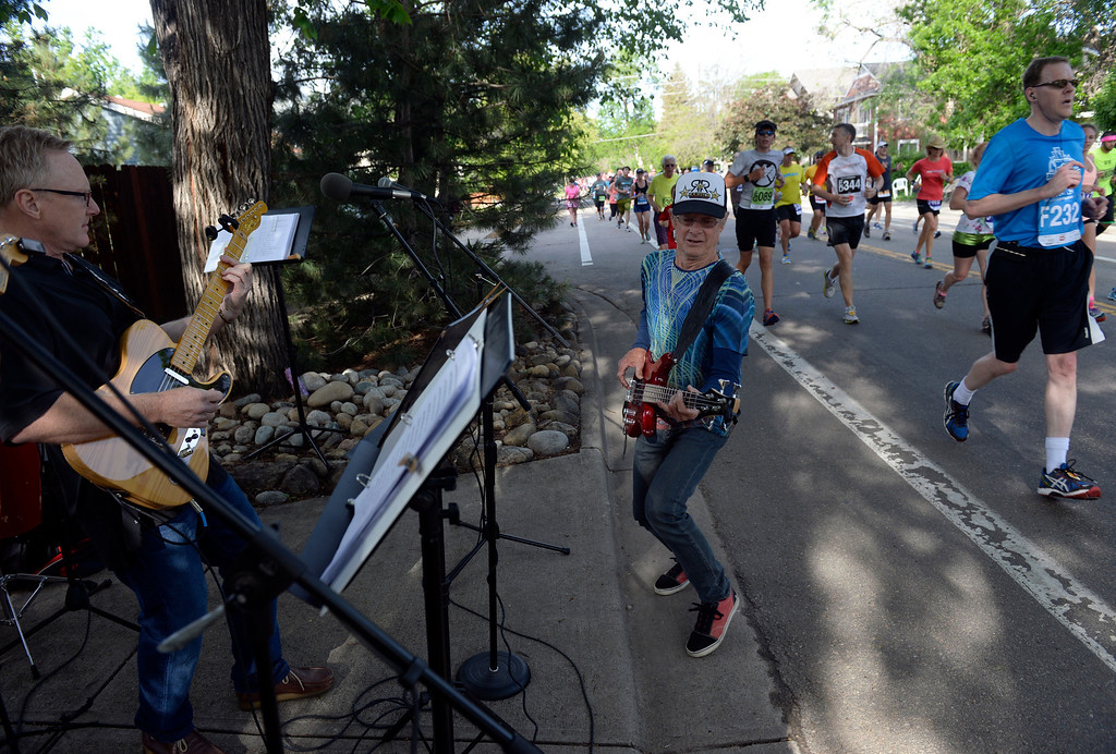 . Jackson Mammele, center, and The Tube Sox band entertain the runners as they make their way down Walnut Street. The 36th BolderBoulder takes place on the streets of Boulder, CO on Memorial Day, May 26, 2014. The 10K event brings winds through the streets of Boulder and finishes at Folsom Field on the University of Colorado campus. (Kathryn Scott Osler, The Denver Post)
