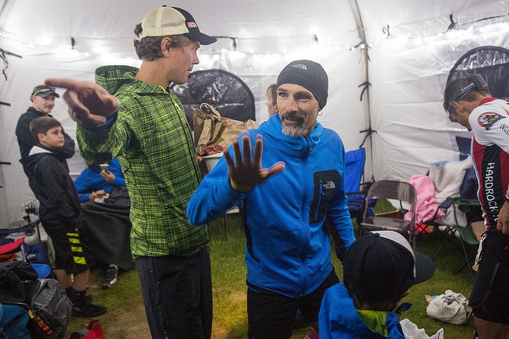 . SILVERTON, CO - JULY 11: Defending champion Sebastien Chaigneau #1 of France, center, waves goodbye to people at the Grouse Gulch aid station because of reported stomach illness during the Hardrock 100 Endurance Run on July 11, 2014, in the San Juan Mountains near Silveton, Colorado. Chaigneau dropped out of the race at mile 58.4. (Photo by Daniel Petty/The Denver Post)