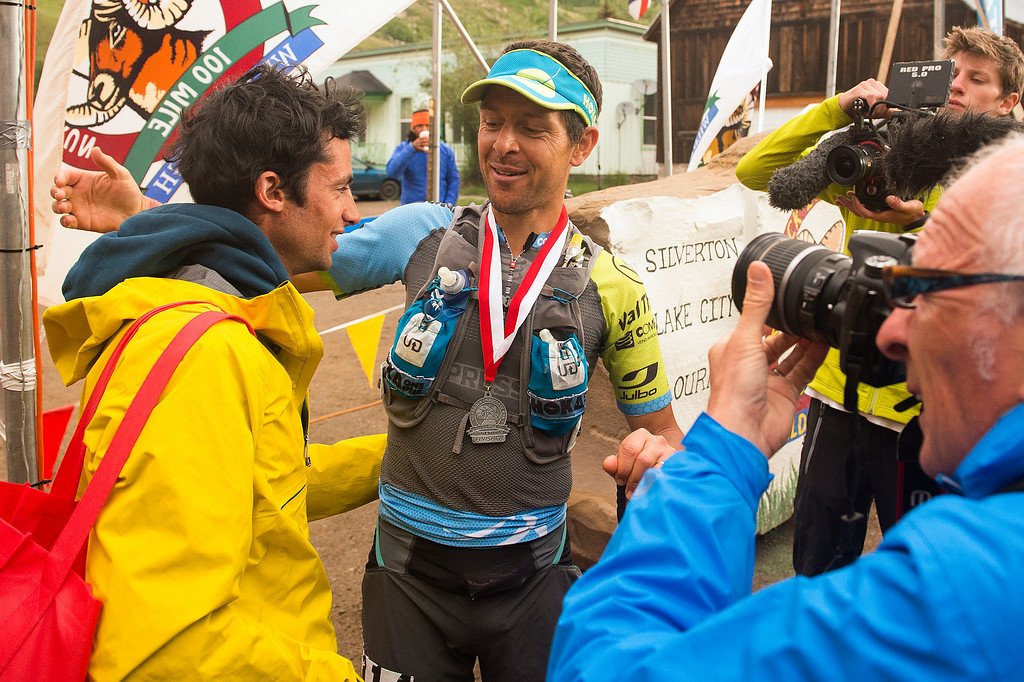 . SILVERTON, CO - JULY 12: Kilian Jornet, left, prepares to embrace Julien Chorier, right, after both finished the 100.5-mile Hardrock 100 Endurance Run on July 12, 2014, in the San Juan Mountains in Silverton, Colorado. Jornet finished first in course record time and Chorier finished second. (Photo by Daniel Petty/The Denver Post)