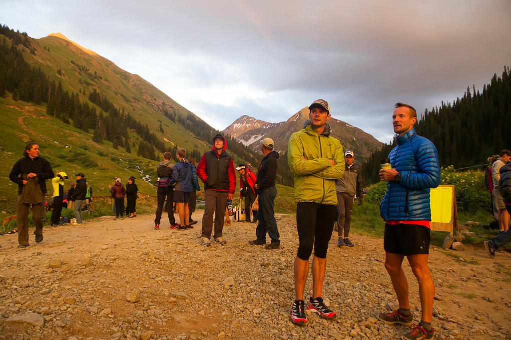 . SILVERTON, CO - JULY 11: Gavin McKenzie, 30, of Leadville (left) and Matt Hart, 39, of Boulder (right) eye a sunset over the San Juan Mountains while waiting at the Grouse Gulch aid station for the runner they will pace during the 100.5-mile Hardrock 100 Endurance Run on July 11, 2014, in the San Juan Mountains near Silverton, Colorado. (Photo by Daniel Petty/The Denver Post)