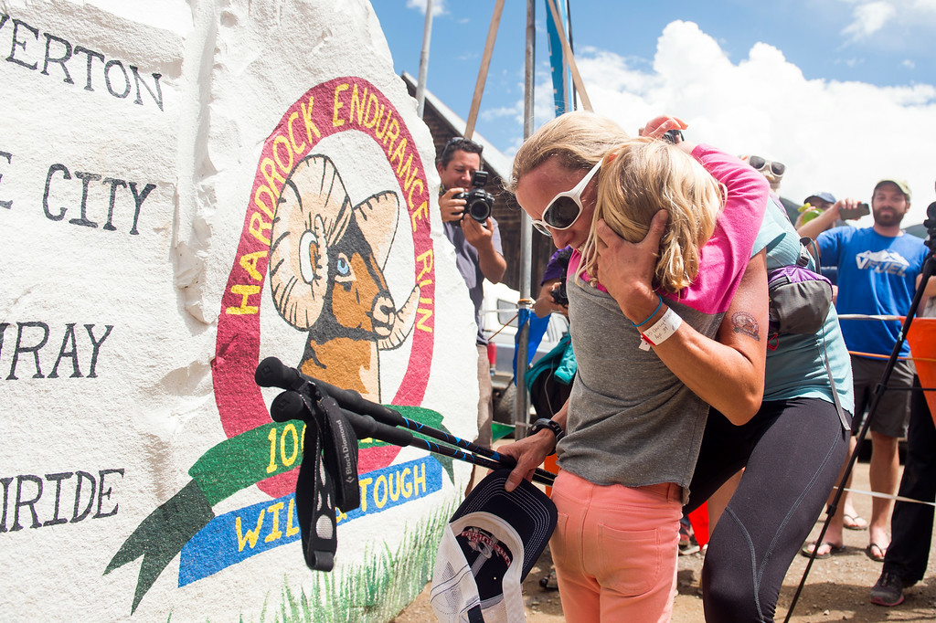 . SILVERTON, CO - JULY 12: Darcy Piceu Africa hugs her daughter, Sophia, after finishing the 100.5-mile Hardrock 100 Endurance Run on July 12, 2014, in the San Juan Mountains in Silverton, Colorado. Africa was the first female to finish, crossing the line in 29:49. (Photo by Daniel Petty/The Denver Post)