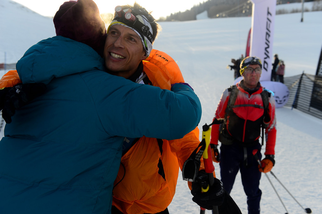 . Jon Brown gets a hug from Glo Cunningham at the finish line, Brown and his teammate Billy Laird finished in third place at the 17th Elk Mountain GORE-TEX Grand Traverse March 29, 2014. Although traditionally the race begins at the base of Mt. Crested Butte at midnight and ends 40 miles away in Aspen, this year, due to harsh conditions, the race began and ended in Crested Butte. (Photo By Mahala Gaylord/The Denver Post)