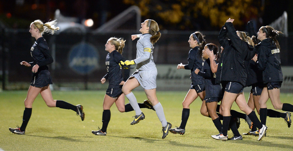 . DENVER, CO. - NOVEMBER 16: University of Colorado players celebrate winning the NCAA women\'s soccer tournament first-round game against the University of Denver at CIBER Field. November 16, 2013. CU won 1-0. (Photo by Hyoung Chang/The Denver Post)