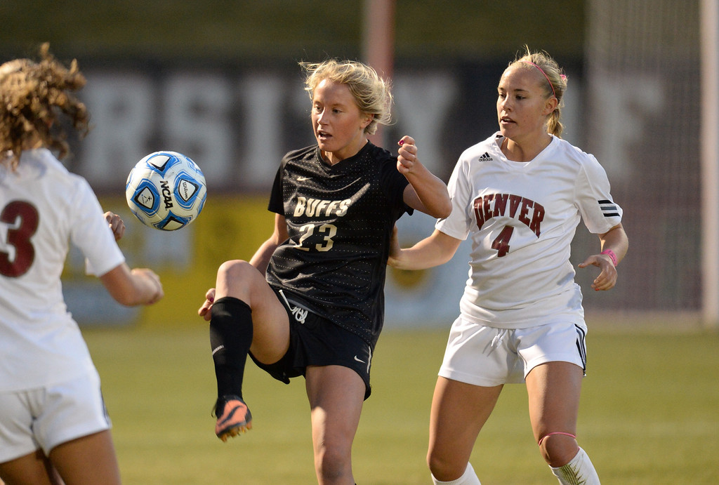 . DENVER, CO. - NOVEMBER 16: Anne Stuller of the University of Colorado (23) and  Sam Harder of the University of Denver (4) , right, fight for the control of the ball in the 1st half of the NCAA women\'s soccer tournament first-round game at CIBER Field. November 16, 2013. (Photo by Hyoung Chang/The Denver Post)