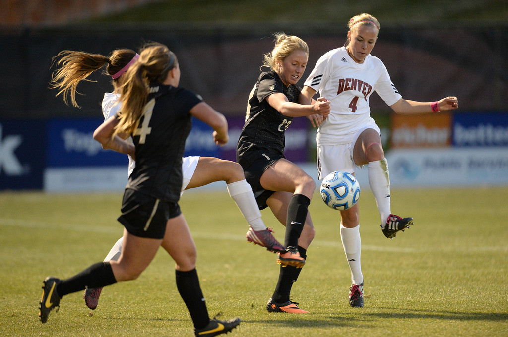 . DENVER, CO. - NOVEMBER 16: Anne Stuller of the University of Colorado (23) and Sam Harder of the University of Denver (4), right, fight for the control of the ball in the 1st half of the NCAA women\'s soccer tournament first-round game at CIBER Field. November 16, 2013. (Photo by Hyoung Chang/The Denver Post)