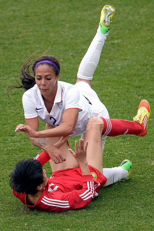 . Sydney Leroux (2) of the U.S.A. and Wang Shanshan (14) of China collide during the second half of the U.S.A.\'s 2-0 win. Dick\'s Sporting Goods Park on Sunday, April 6, 2014. (Photo by AAron Ontiveroz/The Denver Post)