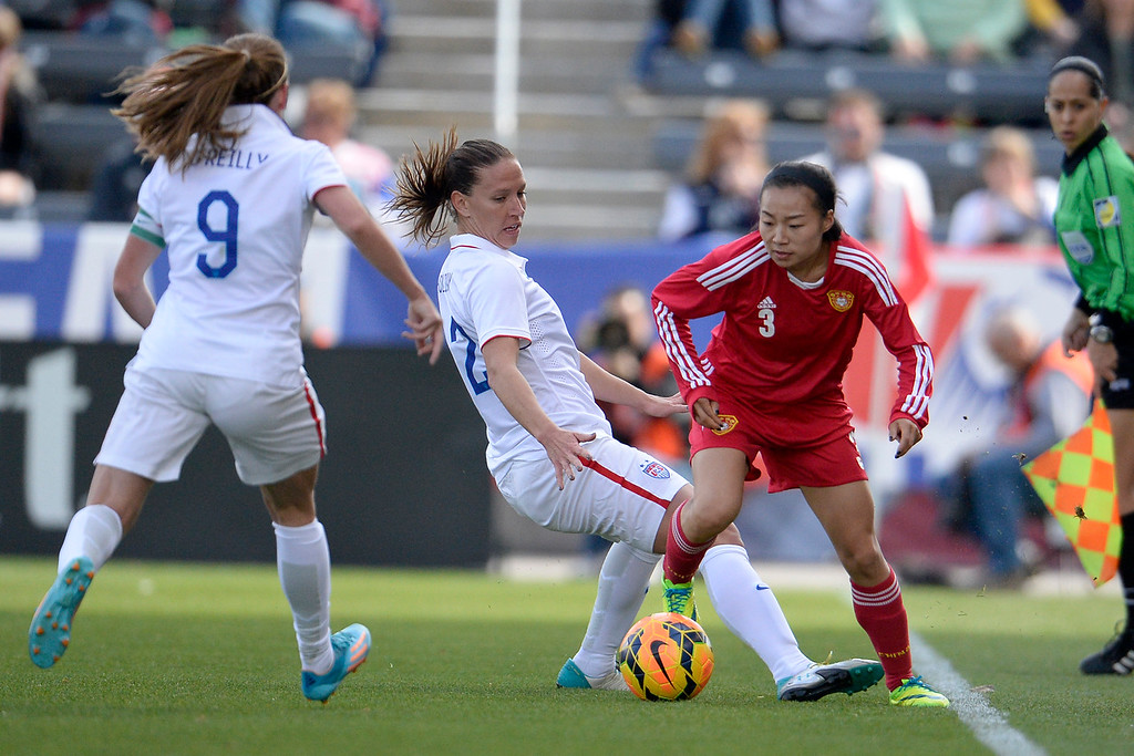 . Lauren Holiday (12) of the U.S.A. defends Wang Lingling (3) of China during the first half of women\'s soccer action. Dick\'s Sporting Goods Park on Sunday, April 6, 2014. (Photo by AAron Ontiveroz/The Denver Post)