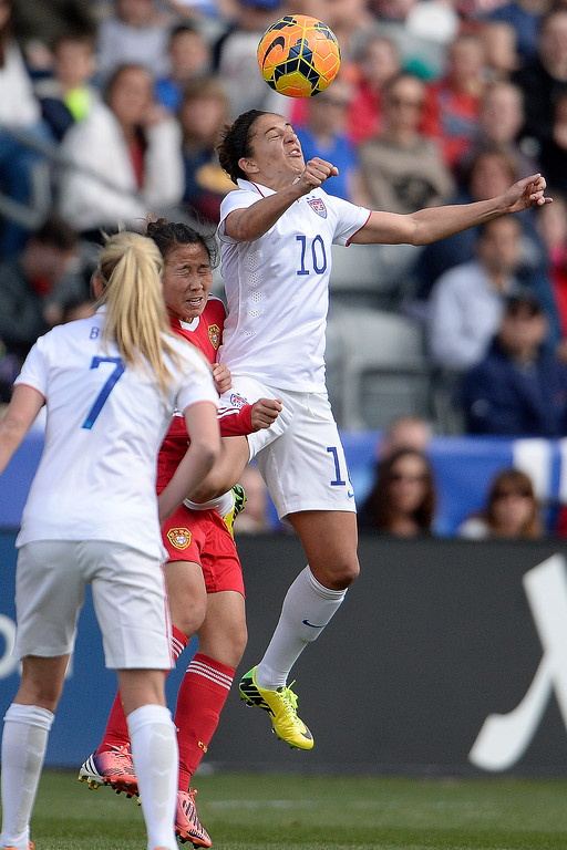 . Carli Lloyd (10) of the U.S.A. heads the ball against China during the first half of women\'s soccer action. Dick\'s Sporting Goods Park on Sunday, April 6, 2014. (Photo by AAron Ontiveroz/The Denver Post)