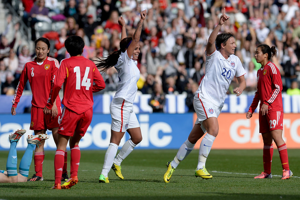 . Sydney Leroux (2) of the U.S.A. and Abby Wambach (20) celebrate a 2-0 goal by Megan Rapinoe (15) against China during team U.S.A.\'s 2-0 win. Dick\'s Sporting Goods Park on Sunday, April 6, 2014. (Photo by AAron Ontiveroz/The Denver Post)
