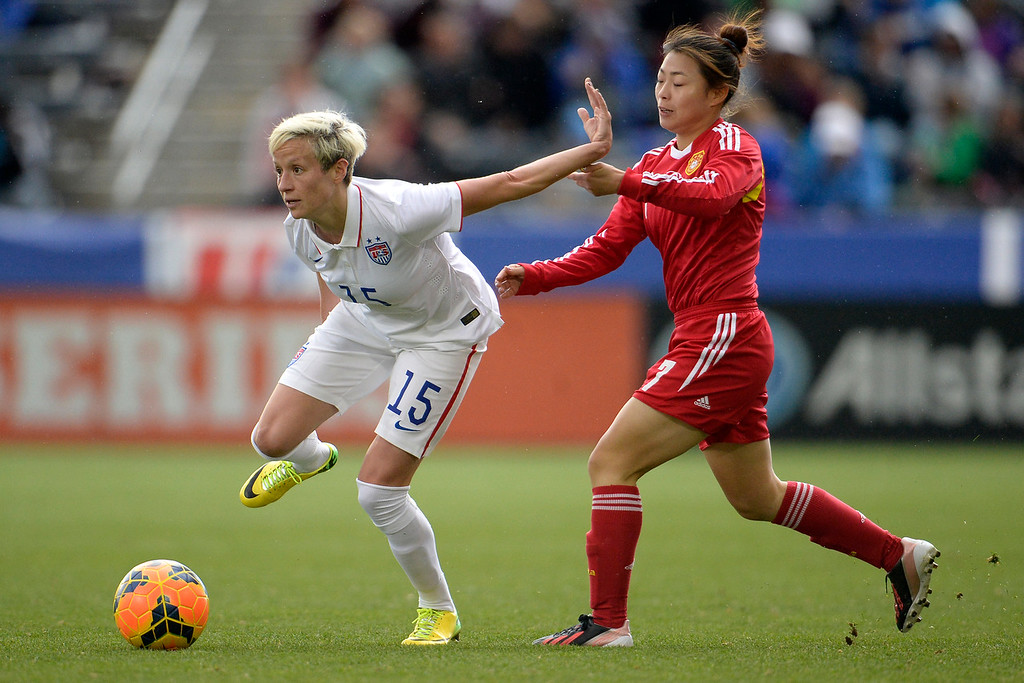 . Megan Rapinoe (15) of the U.S.A. controls the ball as Xu Yanlu (7) of China defends during the second half of the U.S.A.\'s 2-0 win. Dick\'s Sporting Goods Park on Sunday, April 6, 2014. (Photo by AAron Ontiveroz/The Denver Post)