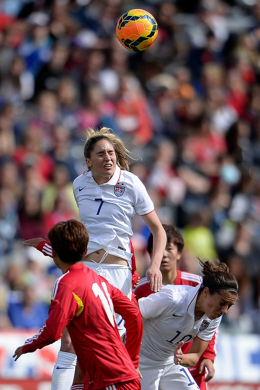 . Morgan Brian (7) of the U.S.A. heads the ball against China during the first half of women\'s soccer action. Dick\'s Sporting Goods Park on Sunday, April 6, 2014. (Photo by AAron Ontiveroz/The Denver Post)