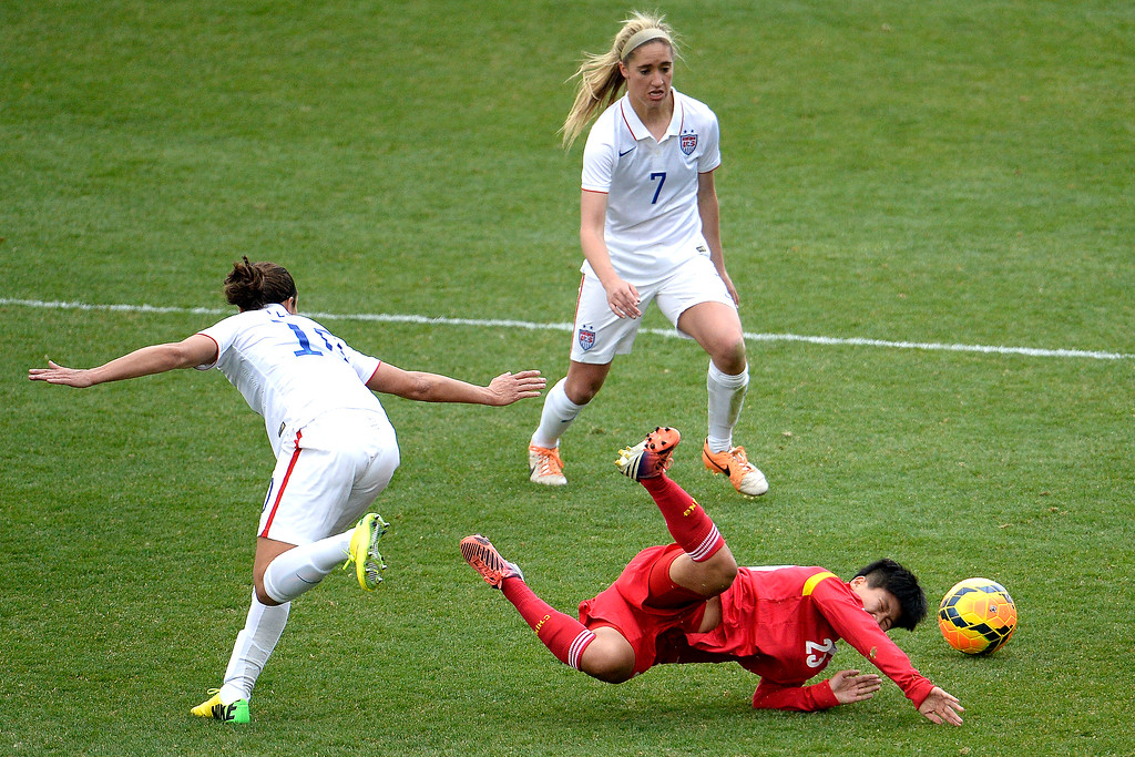 . Carli Lloyd (10) of the U.S.A. and Ren Guixin (23) of China collide during the second half of the U.S.A.\'s 2-0 win. Dick\'s Sporting Goods Park on Sunday, April 6, 2014. (Photo by AAron Ontiveroz/The Denver Post)