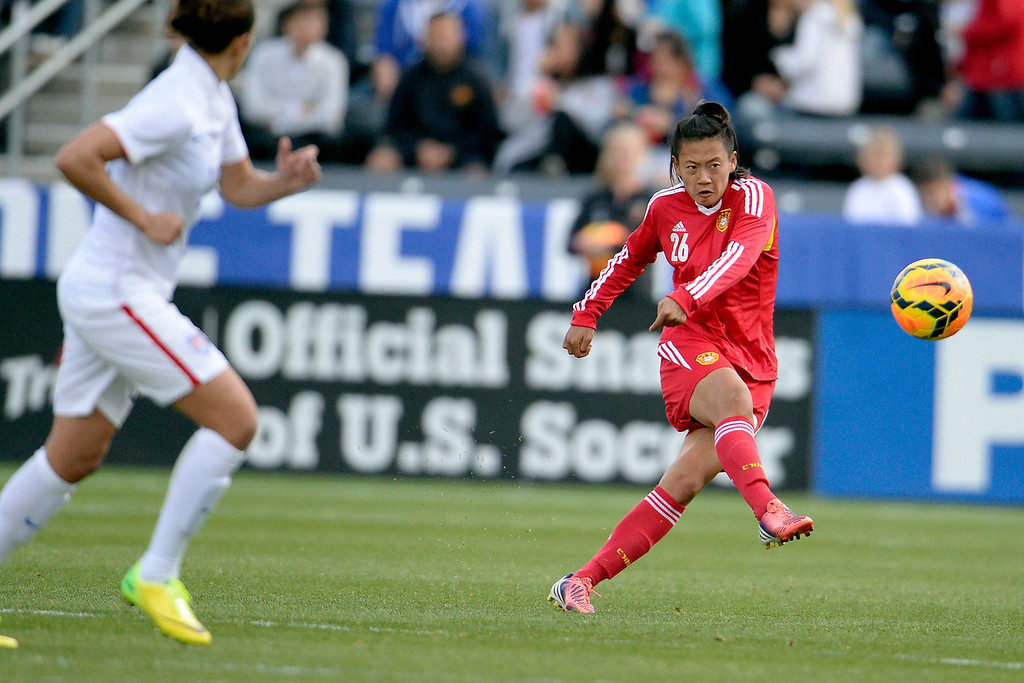 . Li Dongna (26) of China kicks the ball against the U.S.A. during the first half of women\'s soccer action. Dick\'s Sporting Goods Park on Sunday, April 6, 2014. (Photo by AAron Ontiveroz/The Denver Post)